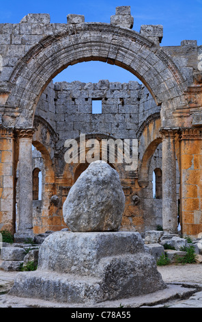 St Simeon's pillar in the ruins of the church of St Simeon, Syria - Stock Photo