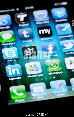 Social Media Apps on Apple iPhone 4 - Stock Photo