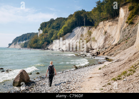 Walkers on beach by Chalk Cliffs near Sassnitz, Jasmund National Park, Ruegen, Mecklenburg Vorpommern, Germany - Stock Photo