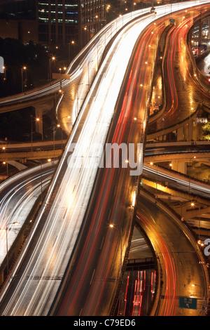 Car trails on Yan'an Rd East Interchange; Luwan; Shanghai; China - Stock Photo