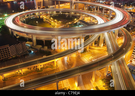 Traffic on roundabout leading to Nanpu bridge at dusk; Dongjiadu: Shanghai; China - Stock Photo