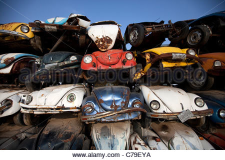 "Old Volkswagen car ""VW beetle"" seized by the government in a junkyard outside of Mexico City. - Stock Photo"