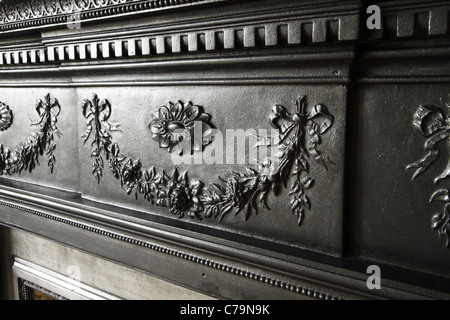 Victorian cast-iron fireplace detail - Stock Photo