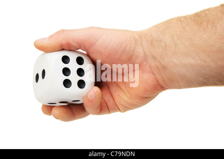a man's hand rolling a giant white die isolated on white - Stock Photo