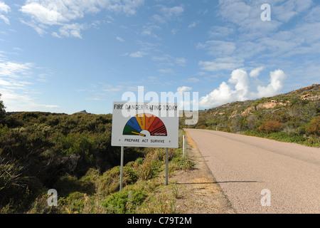 Fire Danger Rating sign & road to Frenchman's Peak, Cape Le Grand National Park, near Esperance, Western Australia, - Stock Photo