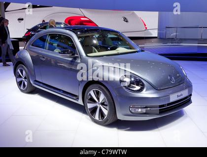 New VW Volkswagen Beetle on the IAA 2011 International Motor Show in Frankfurt am Main, Germany - Stock Photo