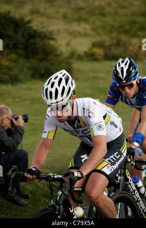cyclist climbing the steep road up the Knockalla Mountains ...