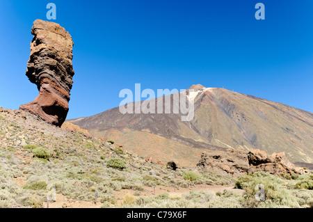 Dedo de Dios or Roque Chinchado or Finger of God, with Teide volcano, Teide National Park, Unesco World Heritage - Stock Photo