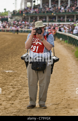 Professional Photographer Jonathan Roberts Shooting Photos on the Track at Churchill Downs in Louisville, Kentucky - Stock Photo