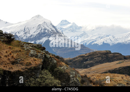 Image from 2500 feet up Rocky Mountain looking toward the distant peak of Mount Aspiring.Central_Otago South_Island - Stock Photo