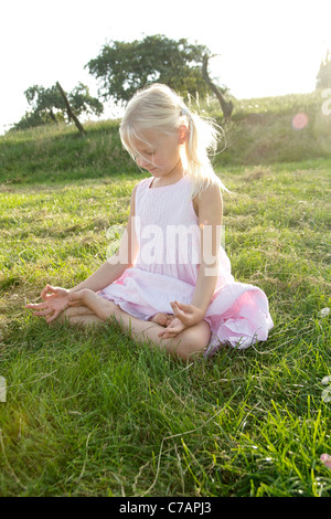 Portrait of a girl practicing yoga in summer, Eyendorf, Lower Saxony, Germany, Europe - Stock Photo