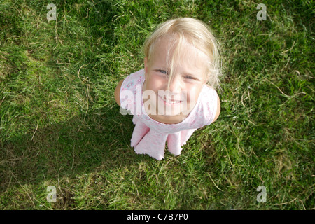 Girl looking upwards in summer, Eyendorf, Lower Saxony, Germany, Europe - Stock Photo