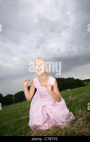 Children playing on a meadow in summer, Eyendorf, Lower Saxony, Germany, Europe - Stock Photo