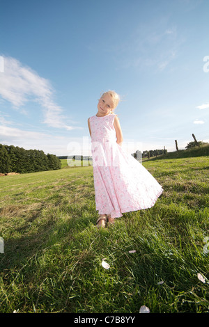 Portrait of a girl standing on a meadow in summer, Eyendorf, Lower Saxony, Germany, Europe - Stock Photo