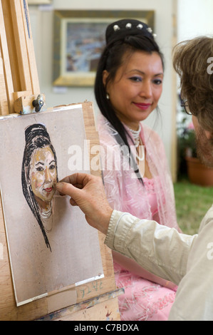 Waterperry Arts in Action 2011 - artist and model 2 - Stock Photo