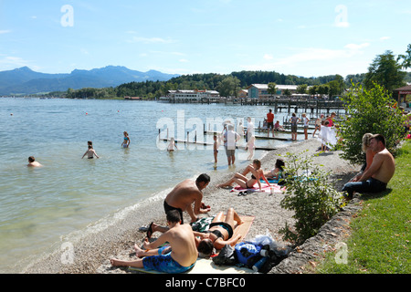 People enjoying summer on the banks of the Chiemsee Lake, Prien Stock Chiemsee Chiemgau Upper Bavaria Germany - Stock Photo