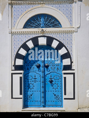 Sidi Bou Said, Tunisia, North Africa, traditional arched doorway with blue studded door, - Stock Photo
