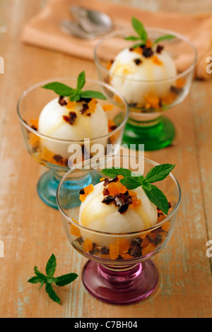 Soft cheese with coconut and dried fruits. Recipe available. - Stock Photo