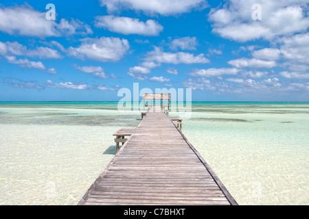 Pier over crystal water in the lagoon, Cayo Guillermo (Jardines del Rey), Ciego de Avila, Cuba - Stock Photo