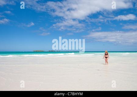Pretty blond woman in bikini strolling along Playa Pilar beach, Cayo Guillermo (Jardines del Rey), Ciego de Avila, - Stock Photo
