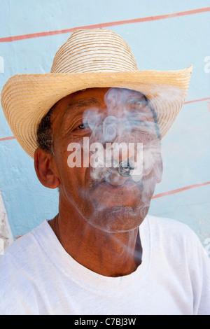 Man smoking a cigar in the old town of Trinidad, Sancti Spiritus, Cuba - Stock Photo