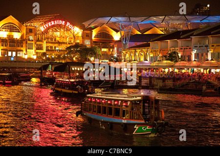 Boats and restaurants at night, Clarke Quay, Singapore river, Asia - Stock Photo