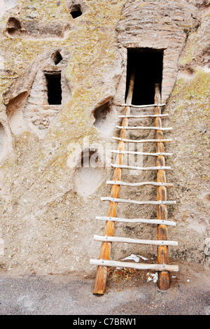 Wooden ladder and cavates, Bandelier National Monument, New Mexico, USA - Stock Photo