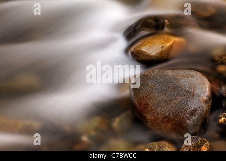 Water flowing over stones in Elwah River, Olympic National Park, Washington - Stock Photo