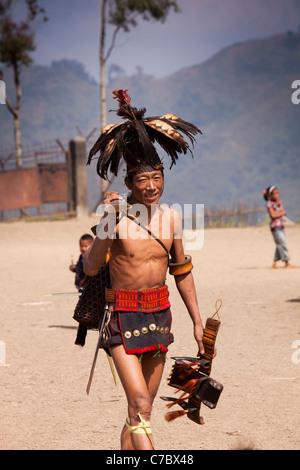 India, Nagaland, Longwa, Konyak Naga warrior in traditional dress, carrying hand made muzzle loading gun - Stock Photo