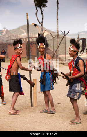 India, Nagaland, Longwa, Konyak Naga warriors in traditional dress, holding hand made muzzle loading guns - Stock Photo
