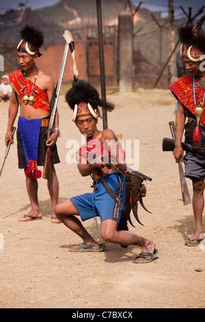 India, Nagaland, Longwa, Konyak Naga warrior in traditional dress, holding hand made muzzle loading gun - Stock Photo