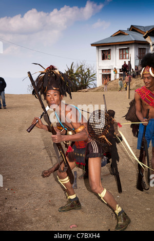 India, Nagaland, Longwa, Konyak Naga warriors in traditional dress in aggressive posture - Stock Photo