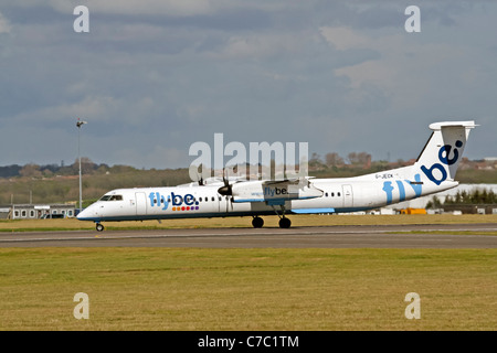 De Havilland Canada DHC-8Q-400 Dash 8, G-JECK, Flybe taking off from Cardiff Airport - Stock Photo