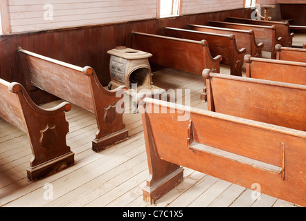 Pot belly stove in interior of Methodist Church, Bodie State Historic Park, California, USA - Stock Photo