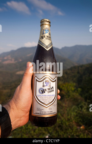 India, Alcohol, He Man 9000 high alcohol, ultra super strong beer in man's hand - Stock Photo