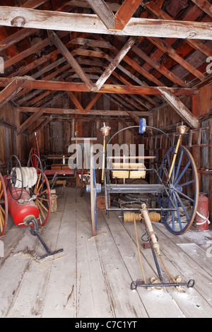 Fire fighting equipment in fire house, Bodie State Historic Park, California, USA - Stock Photo