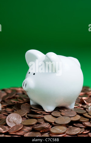 Piggy bank on a pile of pennies - Stock Photo