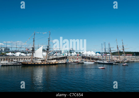 Six tall ships docked at the Quays of Old Port of Montreal - Stock Photo