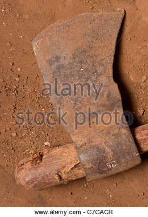 African farming tool weapon - possibly Tanzanian Tanzania Africa (but axe probably made in China attached to local - Stock Photo