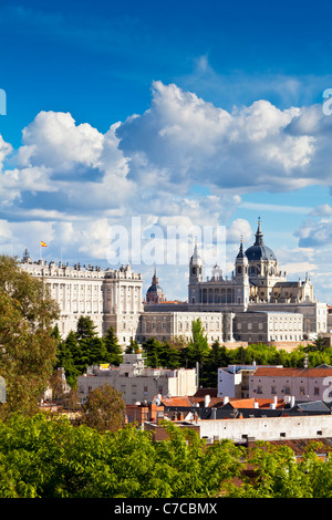 The Almudena Cathedral and the Royal Palace in Madrid, Spain. Beautiful blue sky with fluffy clouds. - Stock Photo