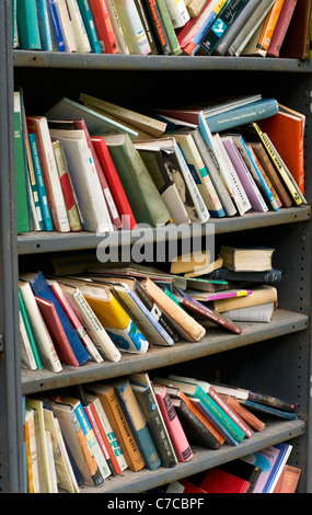 Shelves full of second-hand books on sale at a shop in Hay-on-Wye, Powys, Wales - Stock Photo
