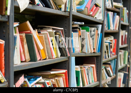 Shelves full of second hand books on sale at a shop in Hay-on-Wye, Powys, Wales - Stock Photo