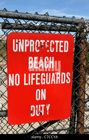 A warning sign indicating no life guards on duty at a oceanfront section of a Monmouth County Park, long Branch, - Stock Photo