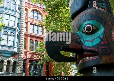 Pioneer Square Totem and Pioneer Building's main entrance in the background, Seattle, Washington, USA - Stock Photo