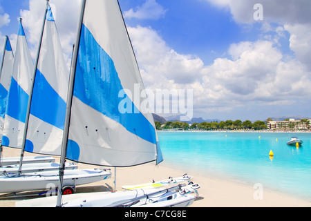 Beach of Puerto de Alcudia in Mallorca with little sailboats and white sand in Majorca - Stock Photo