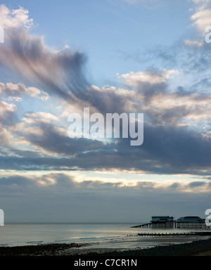 Cromer Beach and Pier at Sunrise in Summer in Norfolk England - Stock Photo