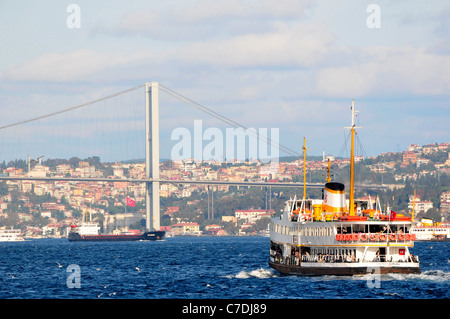 Ferry and the Bosphorus bridge . Golden Horn. Istanbul. Turkey. - Stock Photo