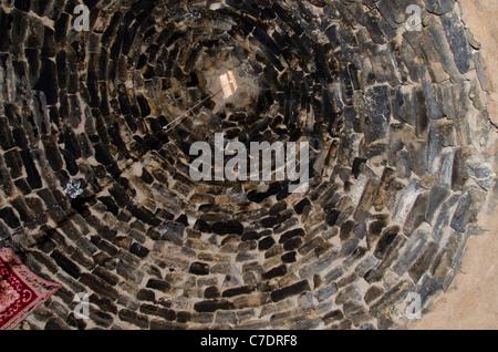 Eastern Turkey, Mesopotamia, ancient city of Harran. Traditional mud 'beehive' homes of Harran. Blackened ceiling - Stock Photo