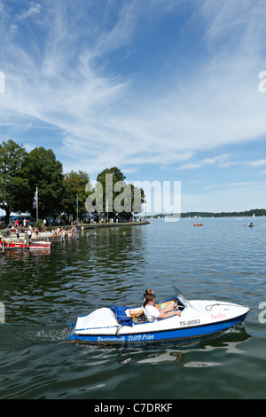 Peddle Boat at the Prien Stock Peninsular in summer, Chiemsee Chiemgau Upper Bavaria Germany - Stock Photo