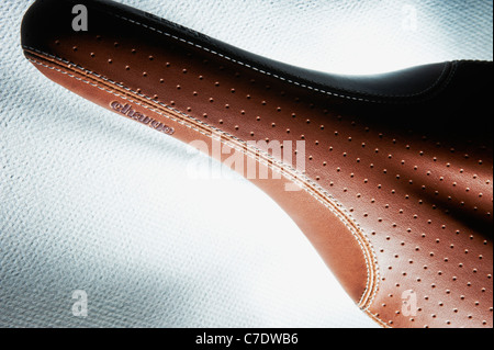 Abstract of bike saddle from above brown tan - Stock Photo